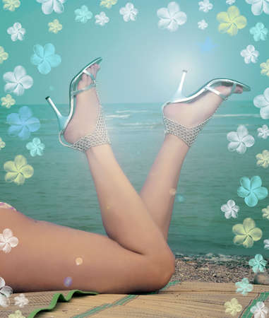 Pretty lady's legs in the silver sandals, on the coast near the sea. Stock Photo - 3689800