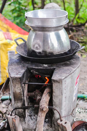 pot hole: Tall pot with hole pan cooking on stoves Editorial