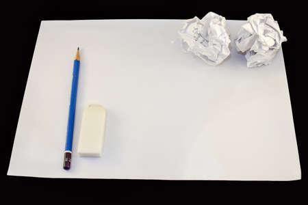 crumpled paper ball: Drawing paper with pencil, rubber and two crumpled paper balls.