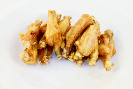 deep fry: Crispy deep fry top half of chicken wings in dish with white isolated background.