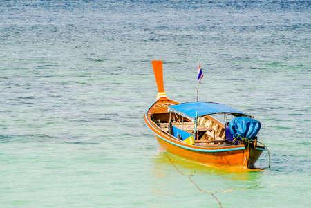 Wooden passenger boat at Li-Pae Island beach Thailand.