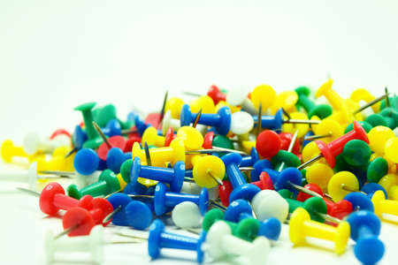 Close up group of colorful pin on white background Stock Photo