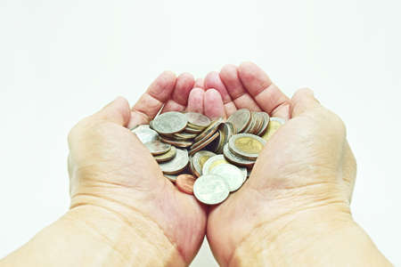 grown up: Close up isolated 2 hand handful with coins, abstract money saving and grown up. Stock Photo