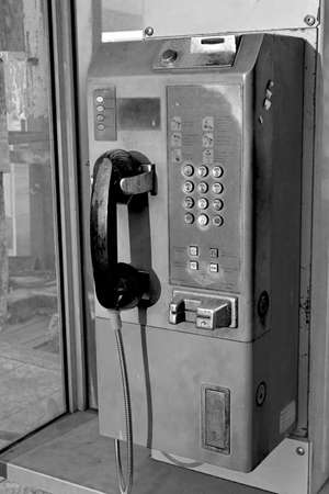 payphone: The public payphone in the box station in black and white style.