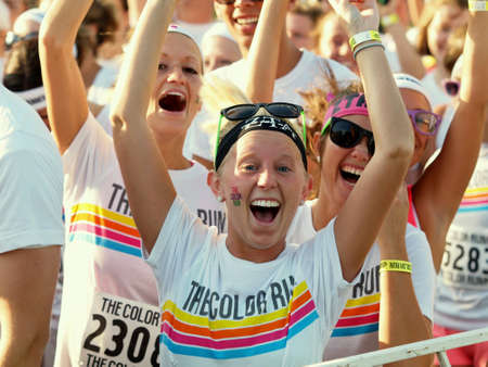 Happy female runners express enthusiasm before start of charity race. Banco de Imagens - 27440059