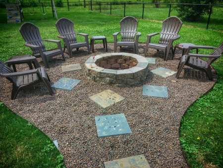 patio chairs: Backyard fire pit with various geometric shapes.