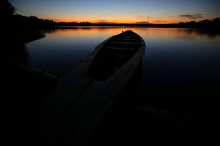 Boat on the Sandoval lake. Puerto Maldonado, Peru. Stock Photo