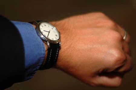 livelihood: Businessman Looking at his Watch