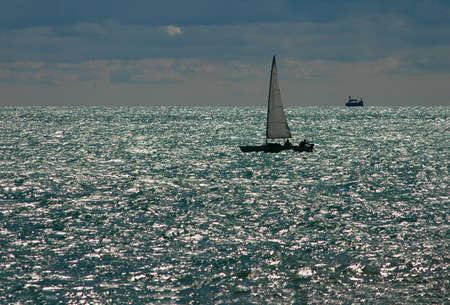 glistening: Sailboat on Glistening Lake Stock Photo