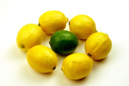 Stand out from the crowd, like this lime in the middle of a circle of lemons. photo