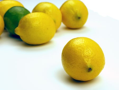 Lemons and limes.  One out in front of the others. photo
