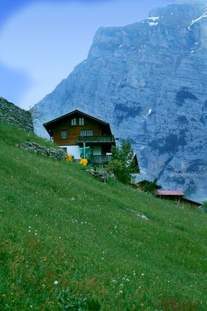 A home in a small villiage of the Swiss Alps, overlooking a dramatic view. Stock Photo - 945354