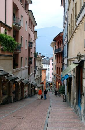 streetlife: Shopping streets of Lugano, Switzerland, with a few shoppers carrying bags.