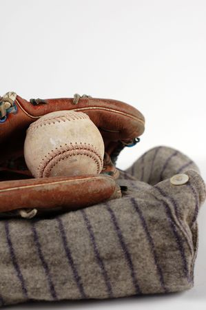 A players old uniform and baseball gear.   photo