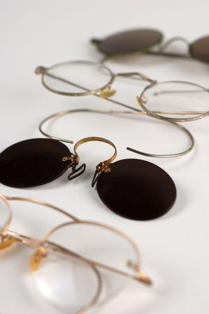 Old pairs of glasses on a white table. Stock Photo - 964658