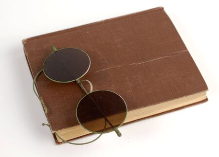 Old glasses and a book on white. Stock Photo - 965639