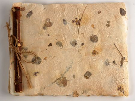 old album: Homemade scrapbook with nice wooden binding and leaf print. Stock Photo