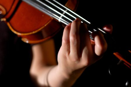 woman violin: A young girl prepares to play her violin.