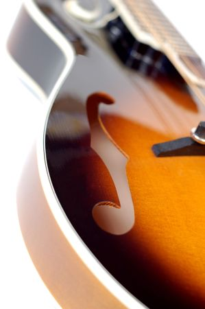 mandolin: Close up of a mandolin on a white background.