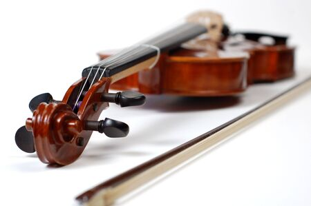 violins: A beautiful violin on a white background.