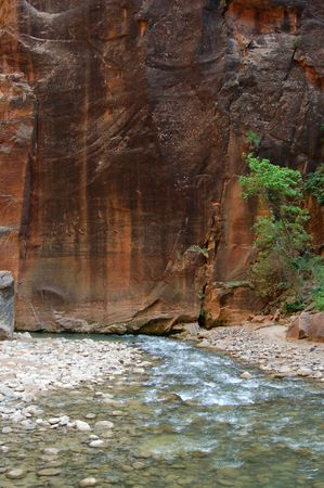 A river runs through the sandstone red rock country in the southwest USA. Stock Photo - 1290516