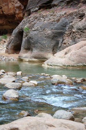 A river runs through the sandstone red rock country in the southwest USA. Stock Photo - 1290517