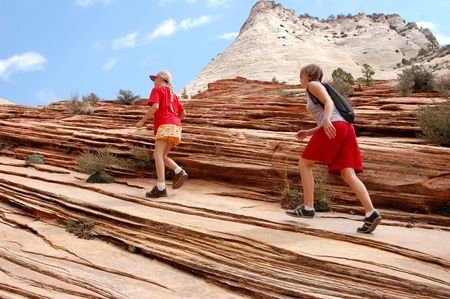 southwest usa: A group hikes in the red rock area of the southwest USA. Stock Photo