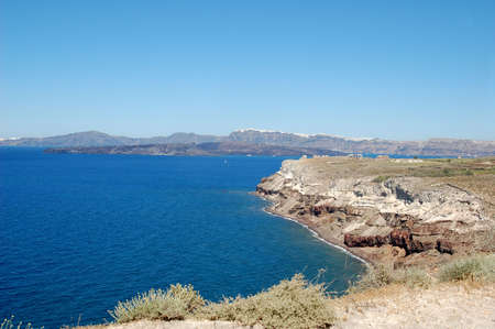 laden: A beautiful view of the cliff laden coastline of a Greek island.