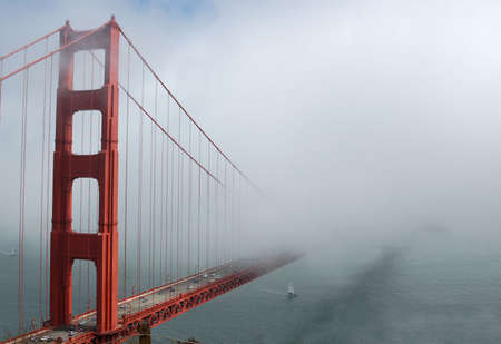 The Golden Gater Bridge in San Francisco, California in a heavy fog.