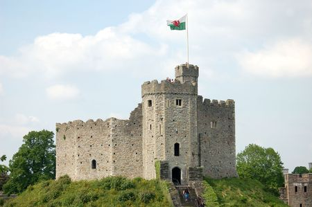 cardiff: Cardiff Castle in summertime with tourists on the grass Stock Photo
