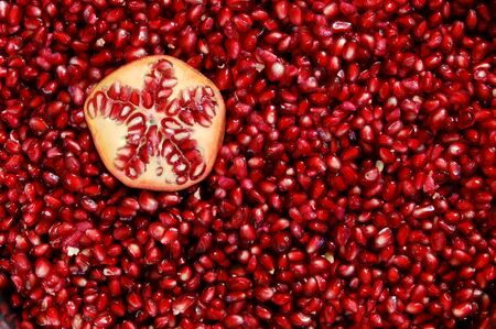 A bowl of freshly cleaned red pomegranate seeds
