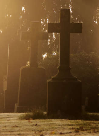 Tombstones with crosses covered in  the morning frost and mist Stock Photo - 1849892