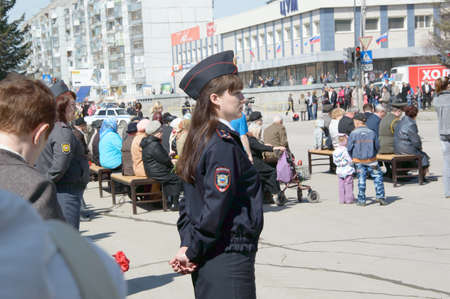 epaulettes: Girl policeman provides law and order during the celebration of the Editorial