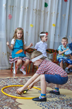 only 3 people: kids a happy holiday and a happy carefree time Editorial