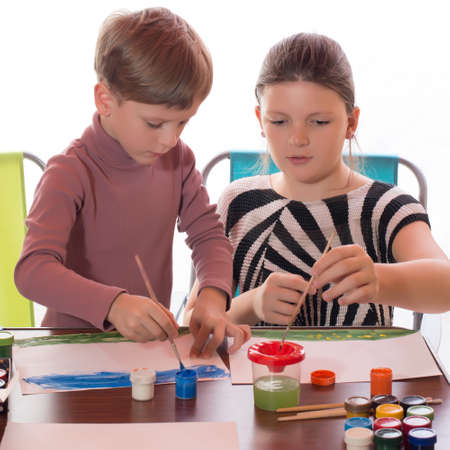 face painting: a boy and a girl having fun painting face painting Stock Photo