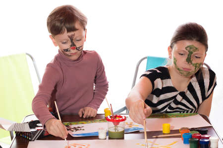 peinture visage: a boy and a girl having fun painting face painting Banque d'images