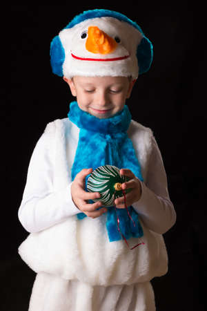 held down: boy in Christmas costume held down  Christmas-tree decoration Stock Photo