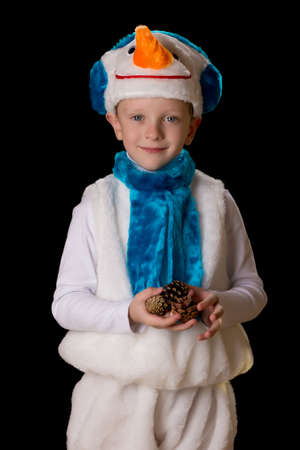 held down: boy in Christmas costume held down spruce cones