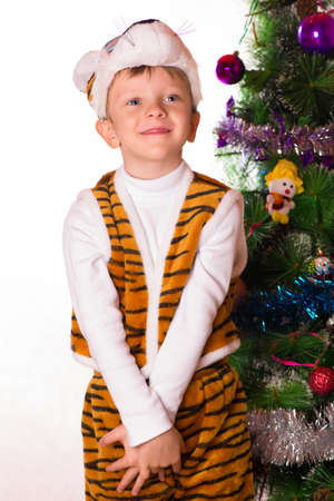celebrated: The boy celebrated new year in a fancy dress