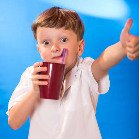liked: the boy very much liked juice in a glass