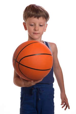 threw: The boy threw a basketball ball an one hand