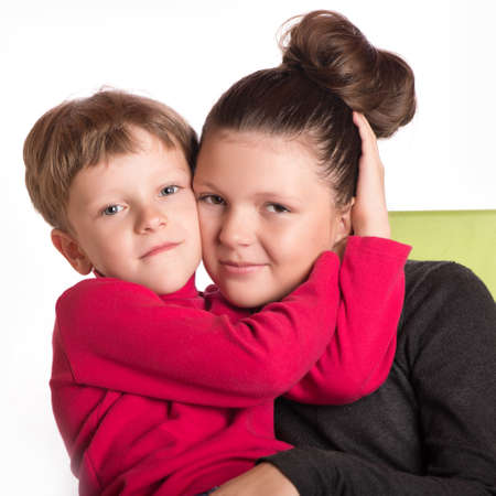 girl care: The boy sat in a lap at the girl embraced