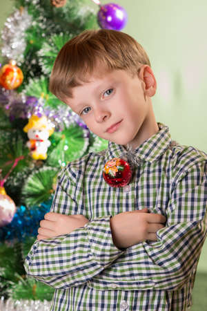 fullface: the boy with fire monkey on the background of Christmas trees Stock Photo
