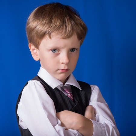 fullface: Portrait of the serious boy of the blonde with blue eyes Stock Photo