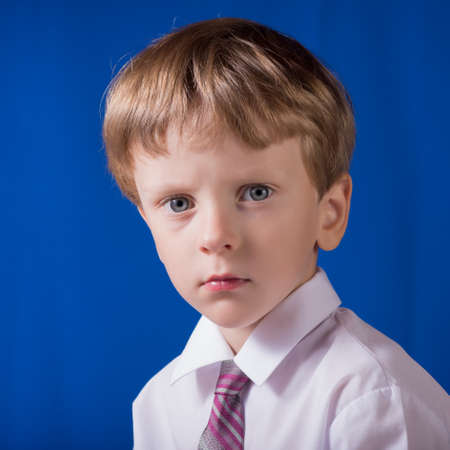 restless: Portrait of the boy of the blonde with blue eyes with a restless eye
