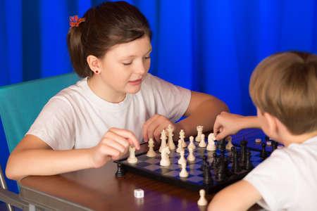 rival rivals rivalry season: Children spend a game of chess .