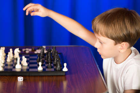 shootout: Children spend a game of chess .