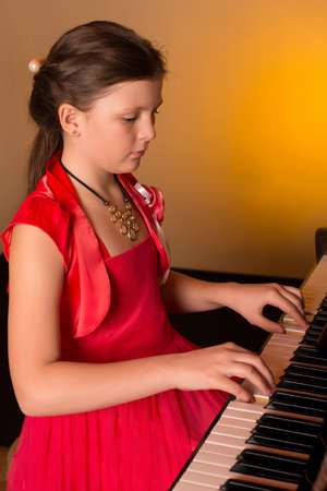 piano player: Young Girl Playing Piano. Piano player.
