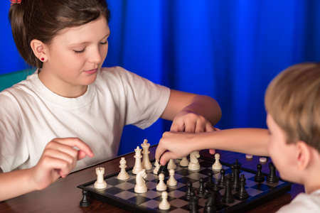proceeds: Children spend a game of chess . Proceeds blitz chess tournament in the palace .