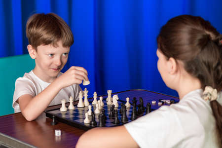 rival rivals rivalry season: Children spend a game of chess . Proceeds blitz chess tournament in the palace .